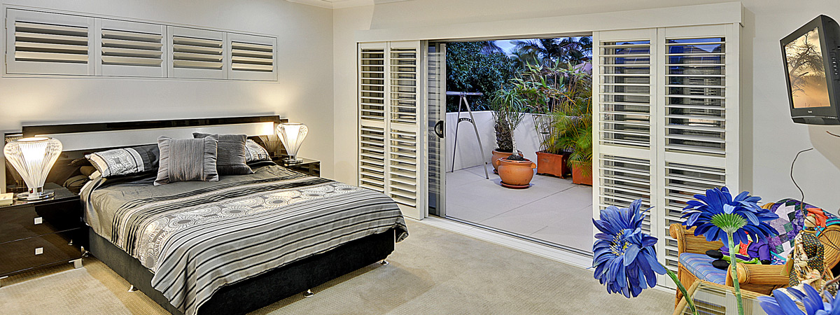 Premium Blinds, Shutters and Curtains - A sunshine coast bedroom featuring premium shutters